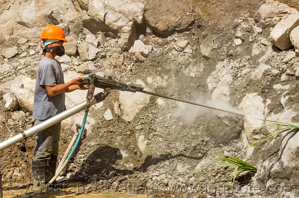 drilling and blasting - road construction (philippines), banaue, drilling and blasting, groundwork, jackhammer, philippines, pneumatic drill, road construction, road work, roadworks, rock, worker, working