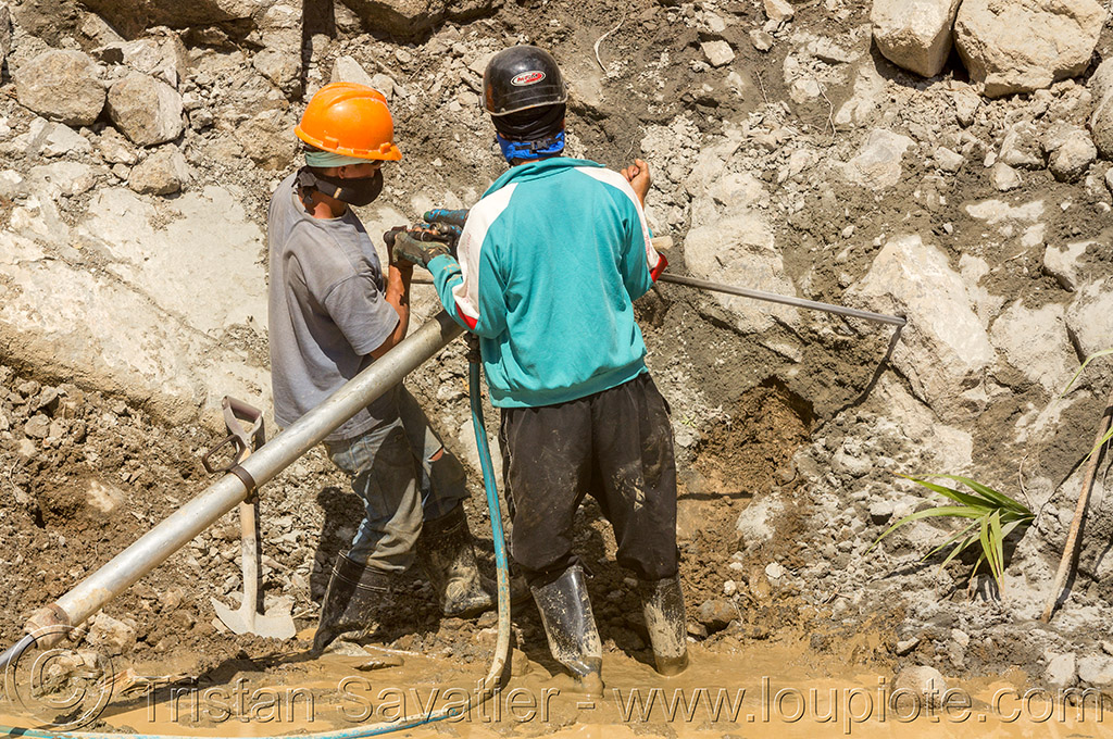 drilling and blasting - road construction (philippines), banaue, drilling and blasting, groundwork, jackhammer, philippines, pneumatic drill, road construction, road work, roadworks, rock, workers, working