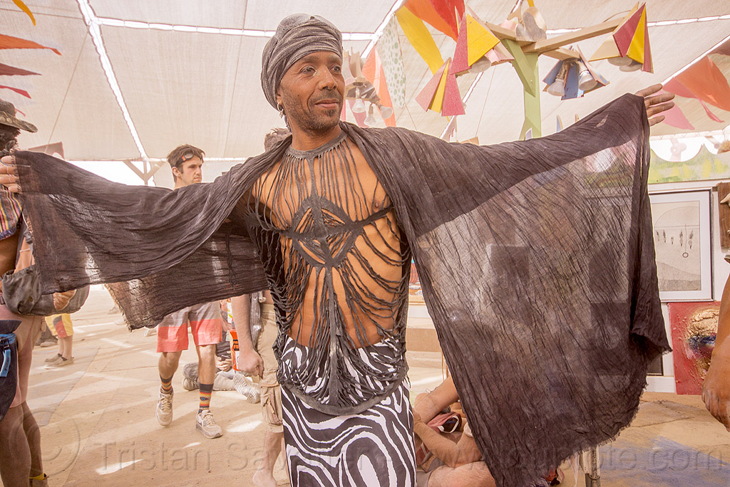 dusty man with black sheer scarf - burning man 2015, burning man, center camp, dusty, fashion, strips