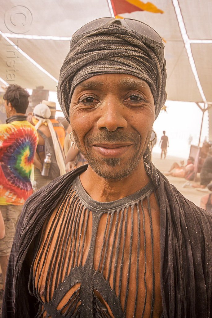 dusty man with black strips top - burning man 2015, center camp, fashion, headdress, people