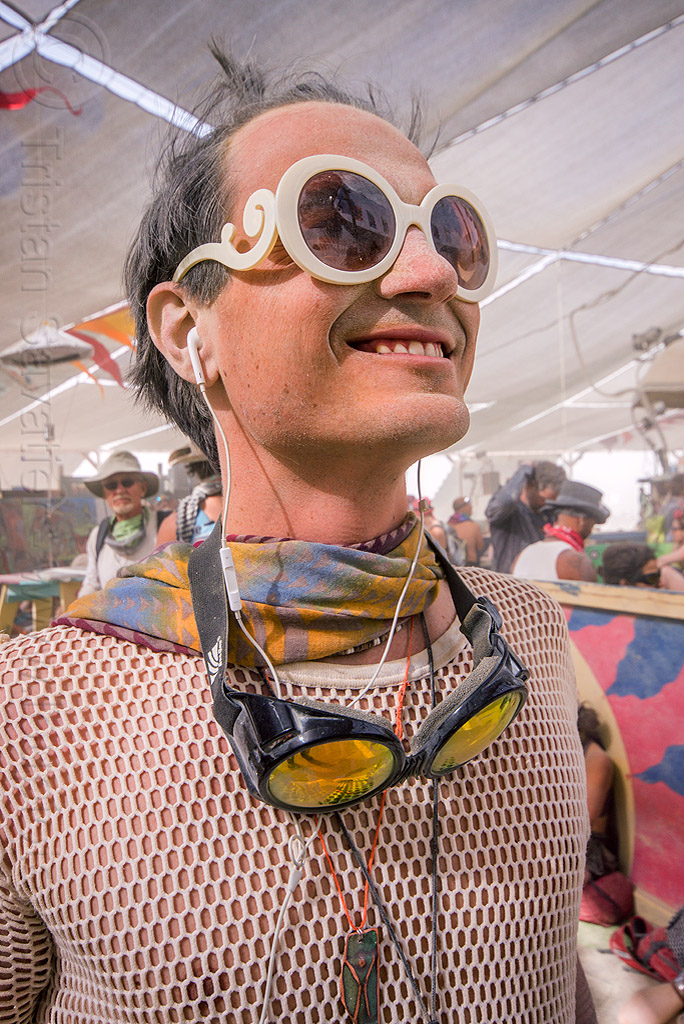 dusty man with white fishnet top at center camp - burning man 2015, burning man, center camp, dusty, fishnet top, goggles, white