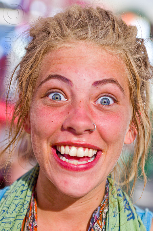 the effect of burning man on a girl's brain - burning man 2012, blonde, burning man, eyes, nose piercing, nose ring, nostril piercing, woman