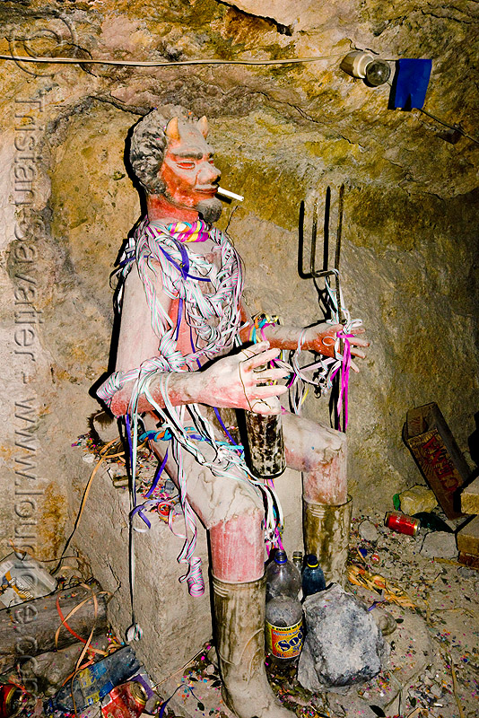 el tio - the spirit of the mine, altar, bottle, cerro rico, cigarette, el el, fork, horns, icon, mina candelaria, mine, mining, offerings, potosí, red, serpentine throws, spirit, tio, tunnel, tío el
