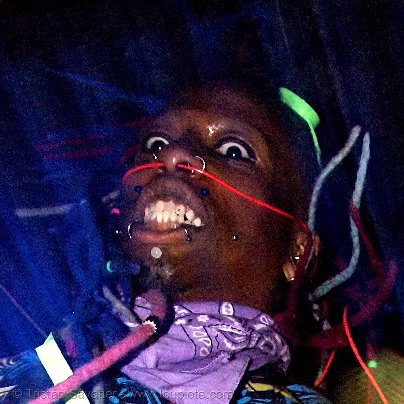 EL wire through septum piercing, african american man, black man, el-wire, ignition party, night, nose piercing, penny, rave party, raver outfits, septum piercing