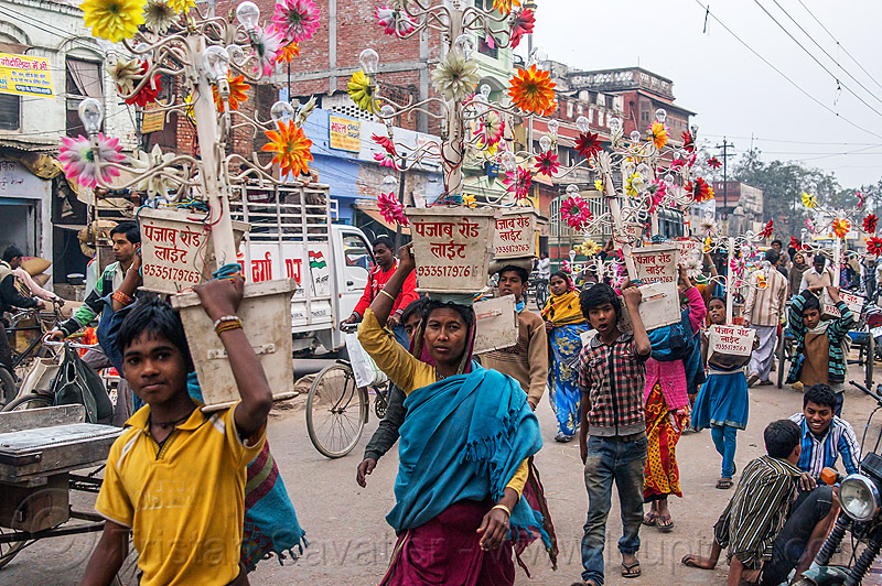electric flowers for wedding (india), electric, flowers, men, street, traffic, transport, transporting, varanasi, walking, wedding, women