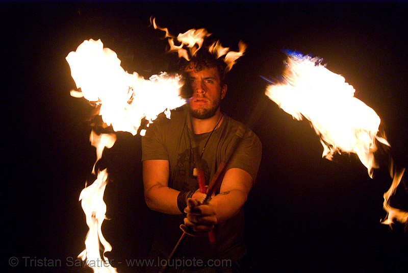 eric spinning fire staffs (san francisco), double staff, fire dancer, fire dancing, fire performer, fire spinning, fire staffs, fire staves, flames, night, spinning fire