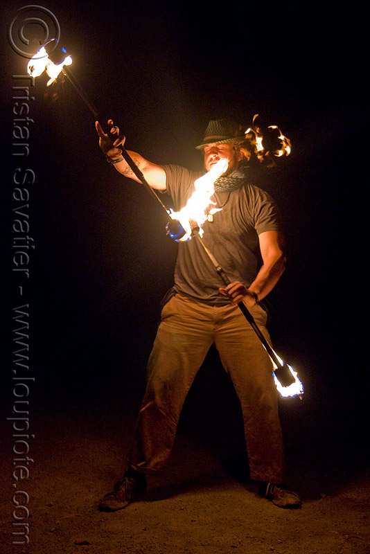 eric spinning fire staffs (san francisco), double staff, fire dancer, fire dancing, fire performer, fire spinning, fire staves, flames, night, people
