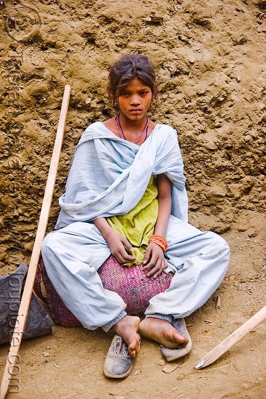 exhausted and dusty young girl resting on trail - pilgrim - amarnath yatra (pilgrimage) - kashmir, amarnath yatra, hiking cane, hindu pilgrimage, india, kashmir, mountain trail, mountains, pilgrim, resting, saree, sari, trekking, walking stick, woman