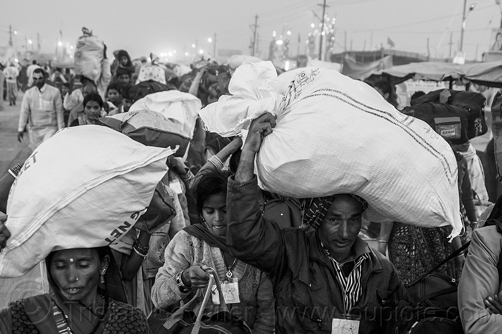 exodus of hindu pilgrims with luggage in bags over head - kumbh mela (india), bags, bundles, carrying on the head, exodus, hindu, hinduism, kumbha mela, luggage, maha kumbh mela, men, night, street, walking, women