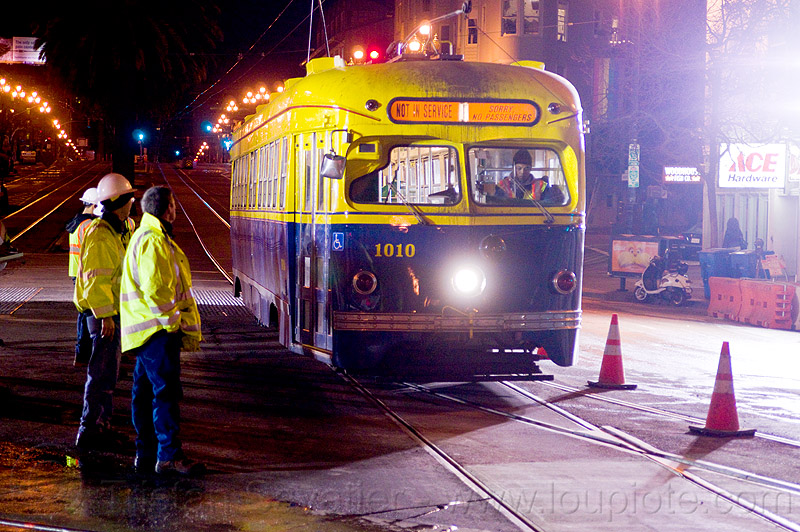 F-market line historical tram car 1010, 1010, high-visibility jacket, high-visibility vest, light rail, man, muni, ntk, railroad construction, railroad tracks, rails, railway tracks, reflective jacket, reflective vest, safety helmet, safety vest, san francisco municipal railway, streetcar, test train, track maintenance, track work, tram, tramway, worker