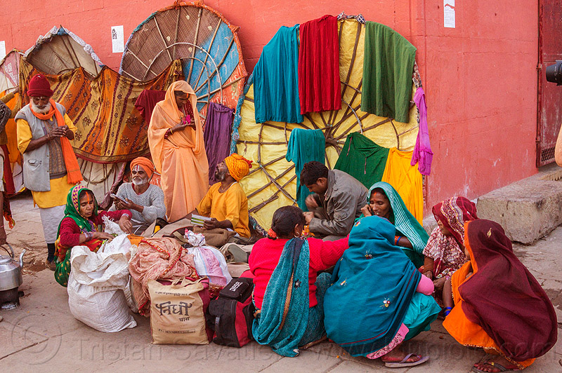 family of hindu pilgrims on the ghats of varanasi (india), colorful, family, ghats, hindu, hinduism, india, men, sitting, squatting, varanasi, women