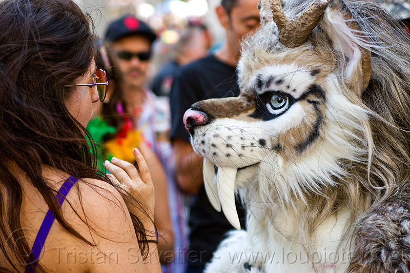 fantasy animal costume with big teeth, animal costume, blue eyes, cosplay, fantasy animal, fur, furry, gay pride festival, long teeth, saber tooth tiger, spottacus, woman