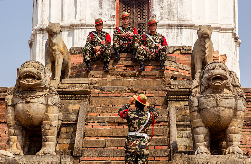 fasidega temple stone lions and gurkha army soldiers on temple steps - bhaktapur durbar square (nepal), bhaktapur, durbar square, fatigues, gorkhas, guards, gurkha army, gurkha regiment, gurkhas, hat, hindu temple, hinduism, men, military, nepalese army, red stripe, sculptures, soldiers, stairs, statue, steps, stone lions, uniform