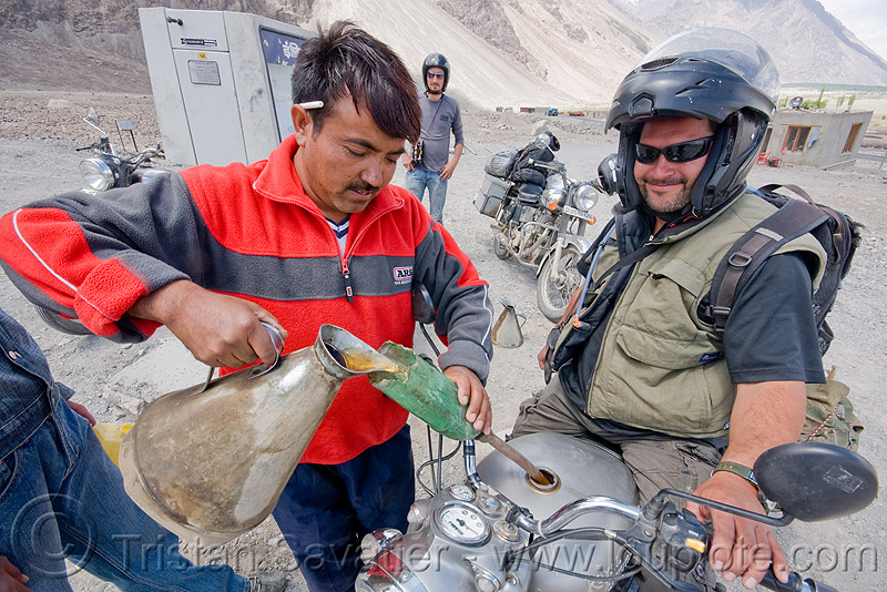 filling-up at the diskit petrol station - nubra valley - ladakh (india), ben, diskit, filling-up, fuel, gas pump, gas station, gasoline, ladakh, motorbike touring, motorcycle touring, nubra valley, petrol pump, petrol station, pouring, road, royal enfield bullet