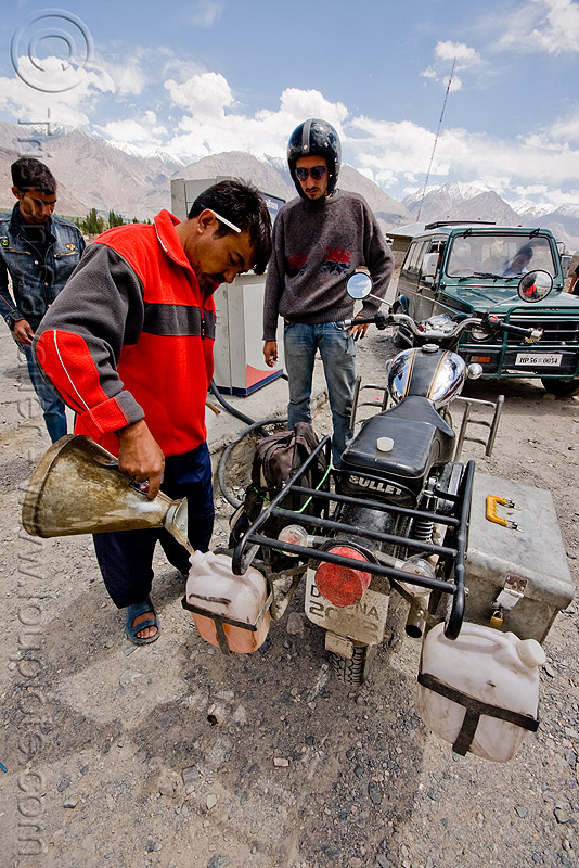 filling-up the jerrycans at the diskit petrol station - nubra valley - ladakh (india), bullet, enfield, fuel, gas, gas pump, gas station, gasoline, manuel, motorbike, motorbike touring, motorcycle, motorcycle touring, people, petrol pump, pouring, road, royal enfield, royal enfield bullet