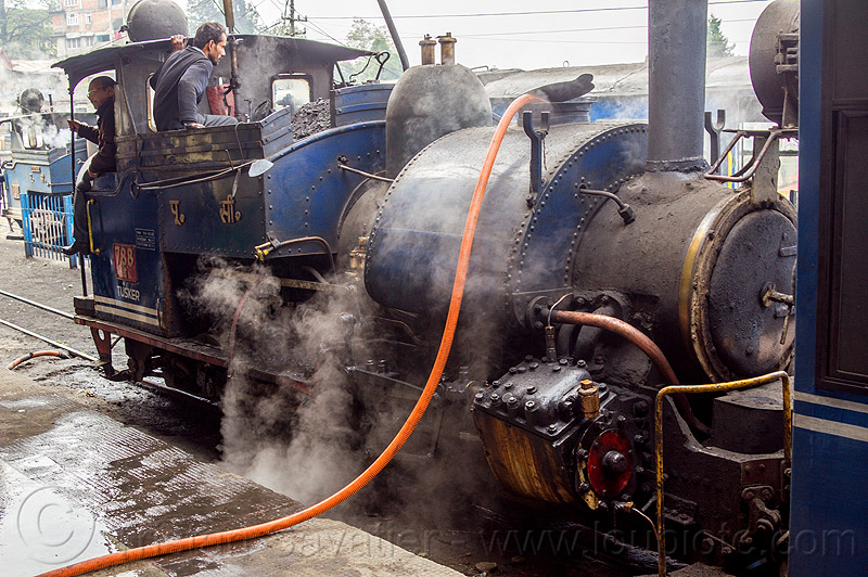 filling-up steam locomotive with water - darjeeling train station (india), 788 tusker, darjeeling himalayan railway, darjeeling toy train, filling-up, hose, men, narrow gauge, operators, railroad, smoke, smoking, steam engine, steam locomotive, steam train engine, train station, water, workers