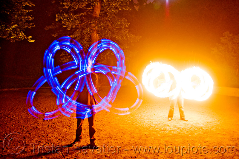 fire and light - spinning light poi - flowlights (san francisco), fire dancer, fire dancing, fire performer, fire spinning, flowtoys, glowing, led lights, led poi, led staff, light staffs, long exposure, nicky evers, night, people, spinning fire