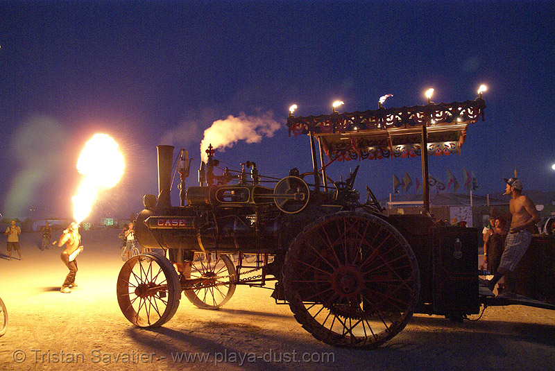 fire breather and kinetic steam works' case traction engine hortense - burning man 2007, art car, back light, burning man, case steam engine, fire breather, fire breathing, fire eater, fire eating, flames, kinetic steam works, ksw, night, steam tractor, steampunk