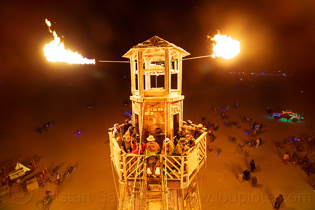 fire cannons on the lighthouse - burning man 2016, art installation, black rock lighthouse, burning man, fire, flames, light house, night