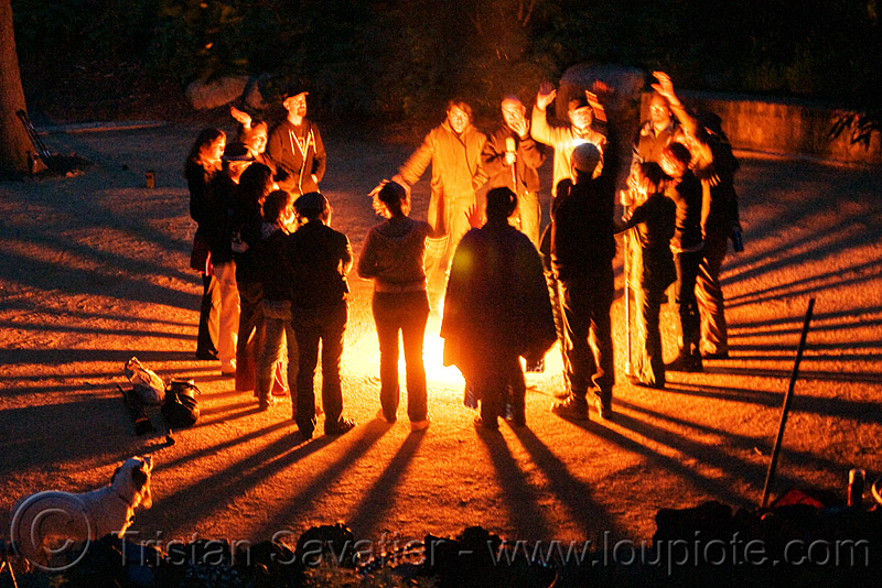 fire circle - light rays, ceremonial, ceremony, fire dancers, fire performers, fire spinning, gathering, night, people, shadows, solar flare
