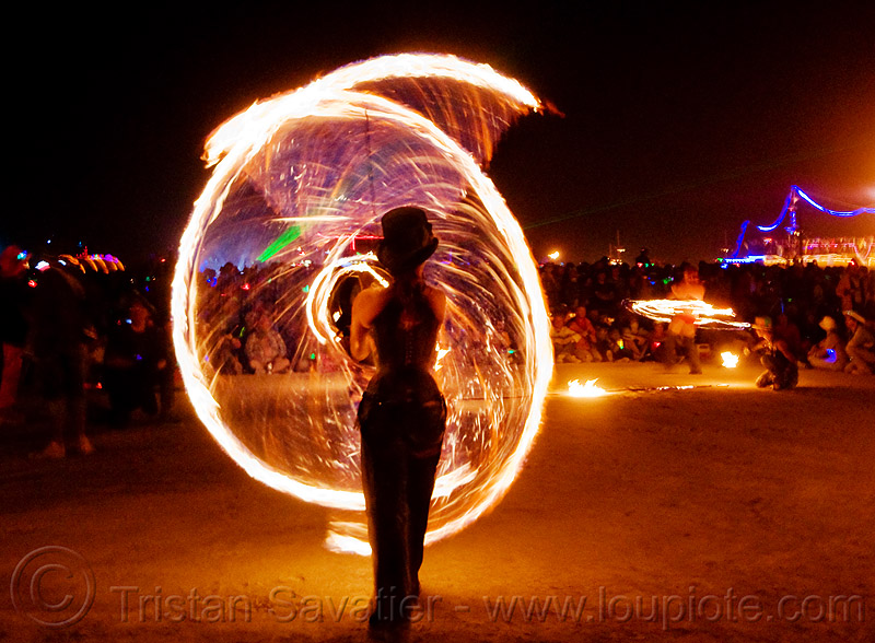 fire conclave - spinning fire ropes - burning man 2009, fire dancer, fire dancing, fire performer, fire spinning, flames, night, night of the burn, people