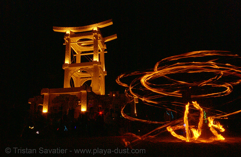 fire dancer near the temple of forgiveness - burning man 2007, burning man, fire dancer, fire dancing, fire performer, fire spinning, night, temple of forgiveness