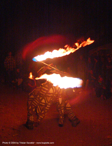 fire-dancer - rainbow gathering - hippie, fire dancer, fire dancing, fire performer, fire spinning, fire staff, hippie, night, spinning fire