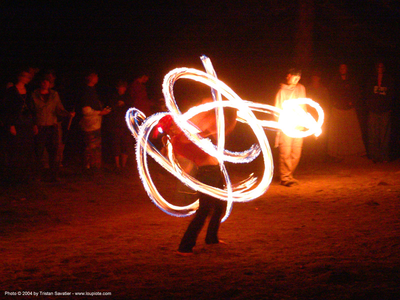 fire-dancer - rainbow gathering - hippie, fire dancer, fire dancing, fire performer, fire poi, fire spinning, flames, long exposure, night, people, rainbow family, spinning fire