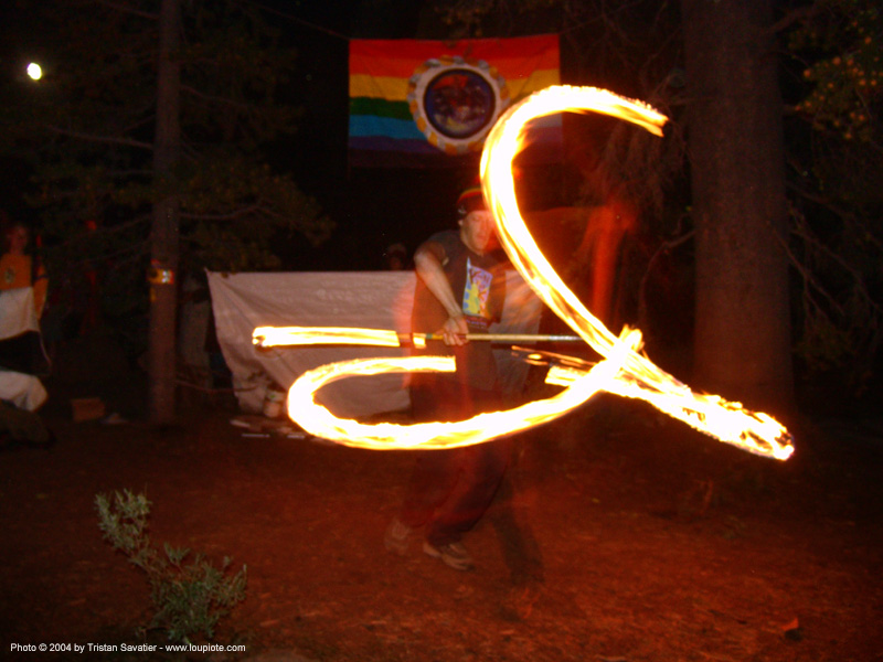 fire-dancer - rainbow gathering - hippie, fire dancer, fire dancing, fire performer, fire spinning, fire staff, flames, hippie, long exposure, night, rainbow family, rainbow gathering, spinning fire