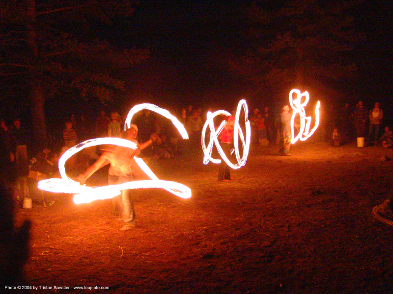 fire-dancers - rainbow gathering - hippie, fire dancer, fire dancing, fire performer, fire poi, fire spinning, flames, long exposure, night, people, rainbow family, spinning fire