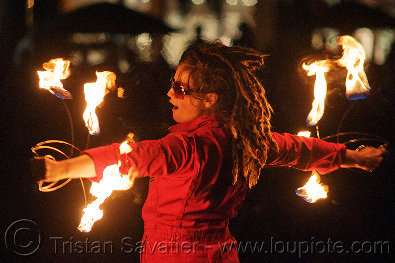 fire fans - performer - temple of poi 2010 fire dancing expo (san francisco), fire dancer, fire dancing expo, fire fans, fire performer, fire spinning, flames, night, red, temple of poi, union square, woman