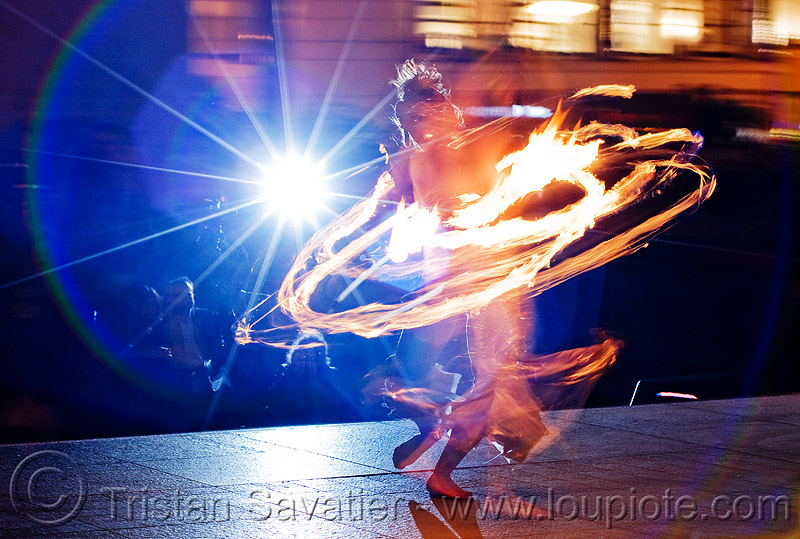 fire hula hoop - performer - temple of poi 2010 fire dancing expo (san francisco), fire dancer, fire dancing expo, fire hulahoop, fire performer, fire spinning, flames, flash, lens flare, long exposure, temple of poi, union square, woman