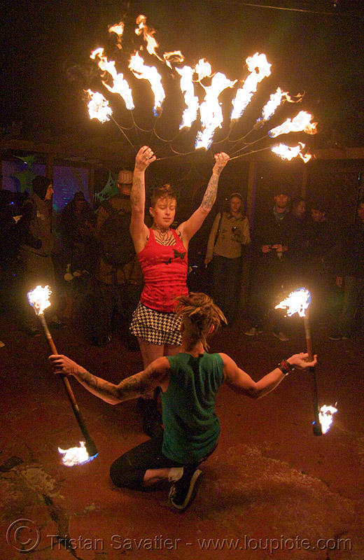 the fire of love - leah and ro spinning fire (san francisco) - fire dancer, double staff, fire dancing, fire fans, fire performer, fire spinning, fire staffs, fire staves, flame, man, night, people, tattooed, tattoos, woman