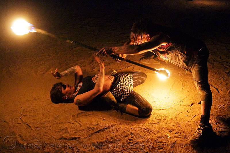 the fire of love - leah and ro with fire staff (san francisco) - fire dancer, bending backward, desert party, fire dancer, fire dancing, fire performer, fire spinning, fire staffs, fire staves, flames, leah, love, man, night, psy trance, rave party, spinning fire, tattooed, tattoos, woman