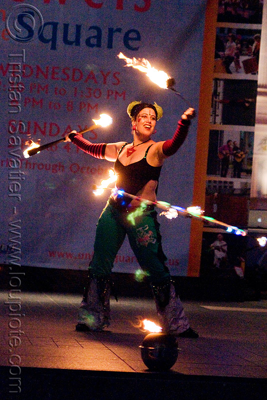 fire performer jamie luv - temple of poi 2009 fire dancing expo - union square (san francisco), fire dancer, fire dancing expo, fire hulahoop, fire performer, fire poi, fire spinning, fire staff, jamie luv, night, spinning fire, temple of poi, woman