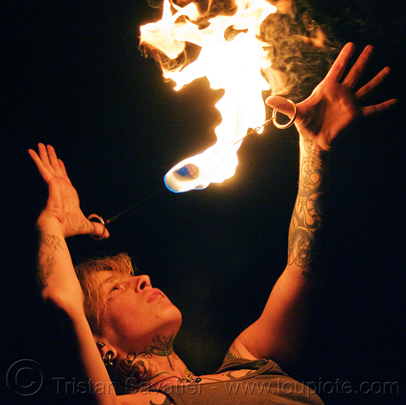 fire performer with fire doohickey, fire dancer, fire dancing, fire doohickey, fire performer, fire spinning, handa, leah, night, tattooed, tattoos, woman
