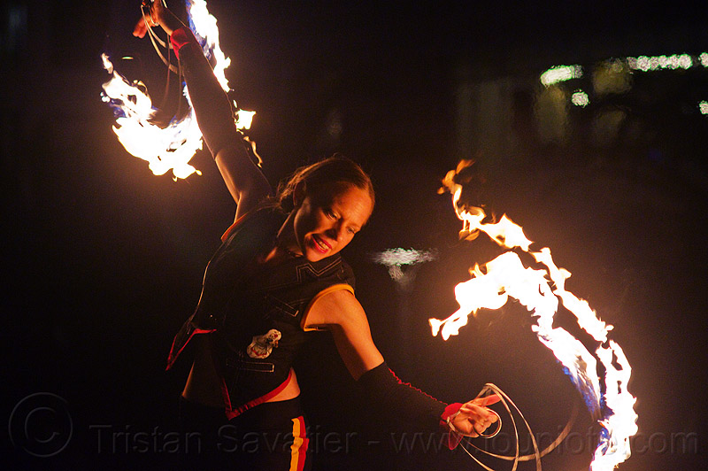 fire performer with fire fans - fire dancing expo (san francisco), fire dancer, fire dancing expo, fire fans, fire performer, fire spinning, flames, night, spinning fire, temple of poi