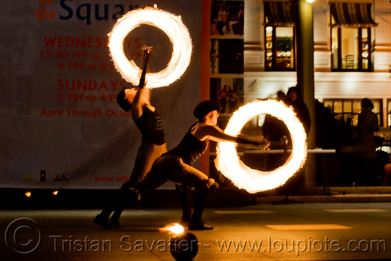 fire performers spinning poi - temple of poi 2009 fire dancing expo - union square (san francisco), circle, fire dancer, fire performer, fire poi, fire spinning, flame, long exposure, night, people, ring, spinning fire, woman