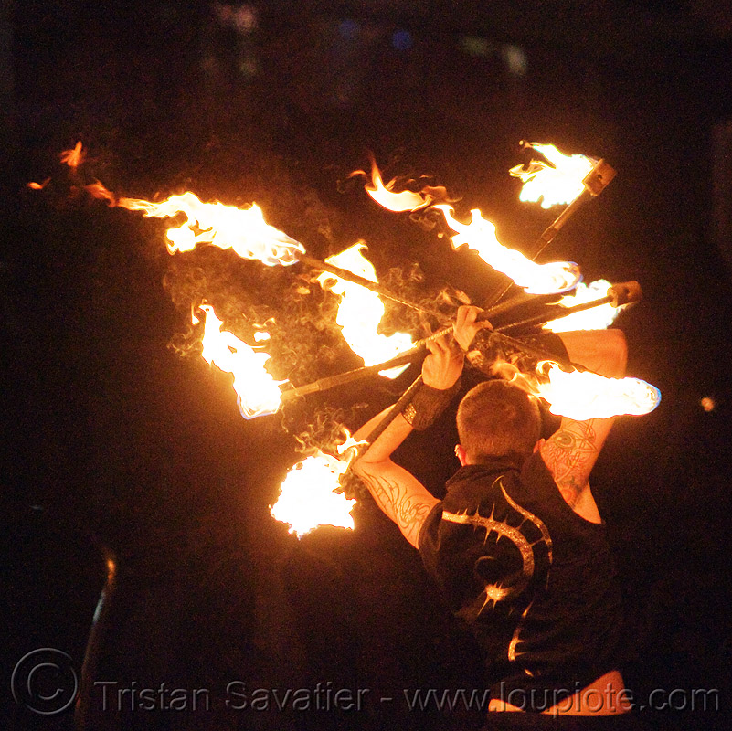 fire staves - performer - temple of poi 2010 fire dancing expo (san francisco), fire dancer, fire dancing expo, fire performer, fire spinning, fire staffs, fire staves, night, temple of poi, union square