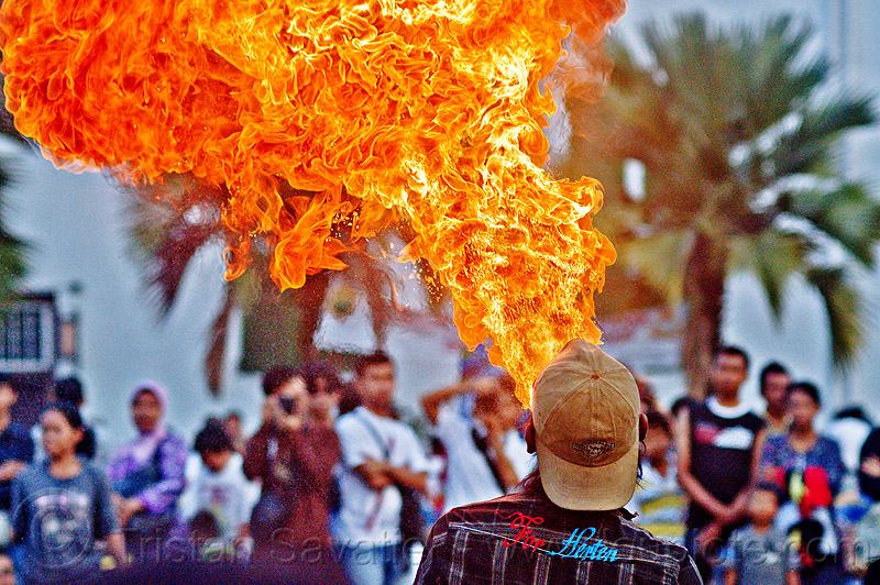 firebreather, crowd, eid, eid ul-fitr, fatahillah square, fire, fire breather, fire breathing, fire performer, flames, jakarta, java, palm trees, people, spectators, spitting fire, street performers, taman fatahillah