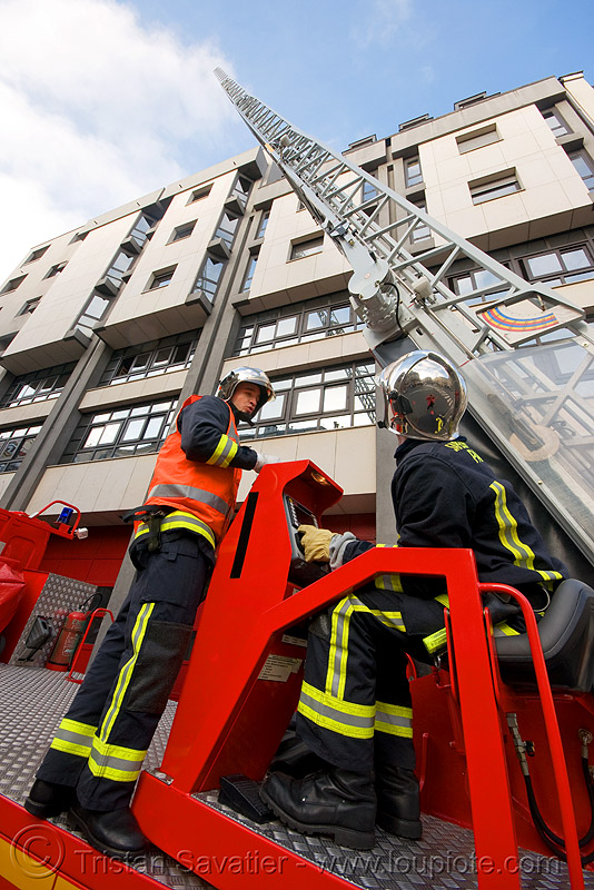 firefighters training with fire truck ladder (paris), fire department, fire engine, fire truck ladder, firefighters, ladder fire truck, ladder truck, lorry, paris, pompiers, red, street, training