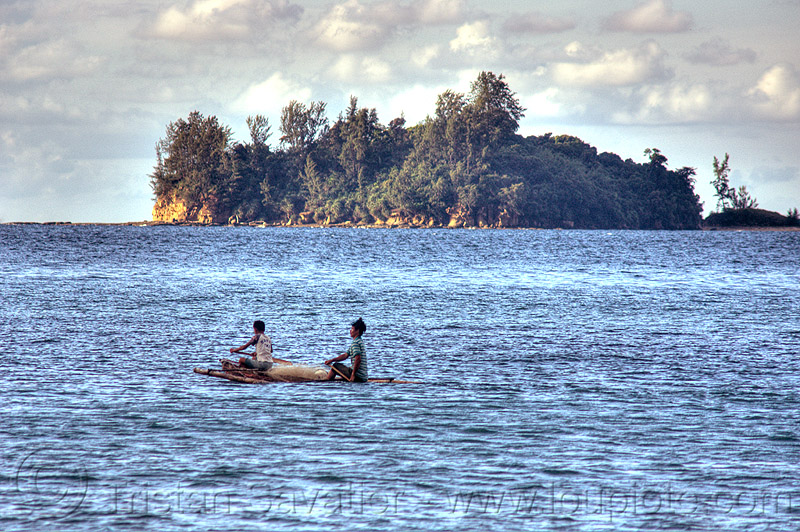 fishermen on small double outrigger canoe, bangka, boy, double outrigger canoe, fisherman, fishermen, fishing canoe, fishing net, island, kelambu beach, man, ocean, paddles, paddling, rain forest, river boat, rowing boat, sailing, sand, sea, seashore, shore, small boat