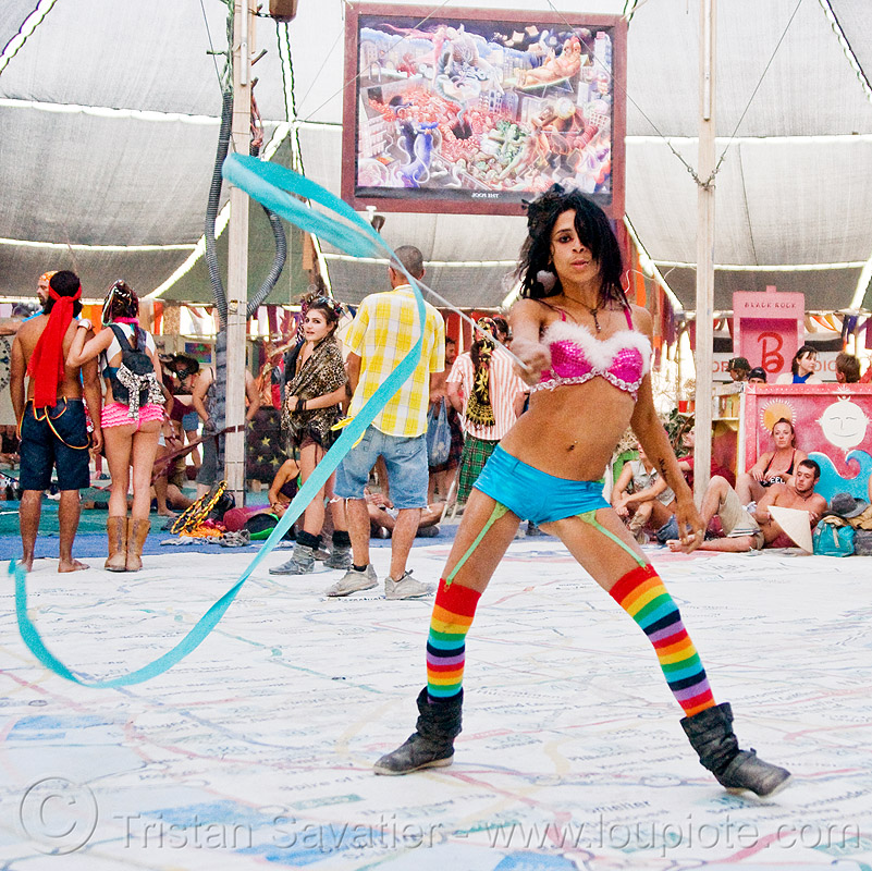 flowing ribbon, blue ribbon, burning man, flowing ribbon, performance, rainbow colors, rainbow stockings, rainbow tights, woman