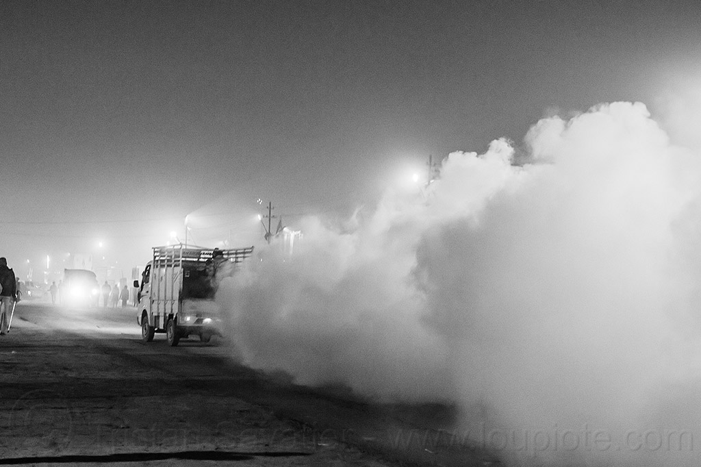 fogging truck spraying DDT insecticide at kumbh mela 2013 (india), air quality, ddt, environment, fog truck, fogger truck, fogging, hindu pilgrimage, hinduism, india, insecticide, lorry, maha kumbh mela, night, pollution, smog, spray, spraying, white smoke