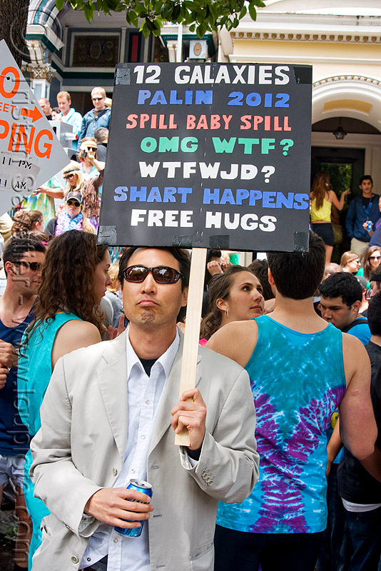 frank chu impersonator, 12 galaxies, bay to breakers, costume, crowd, festival, man, picket sign, protester, protesting, sunglasses