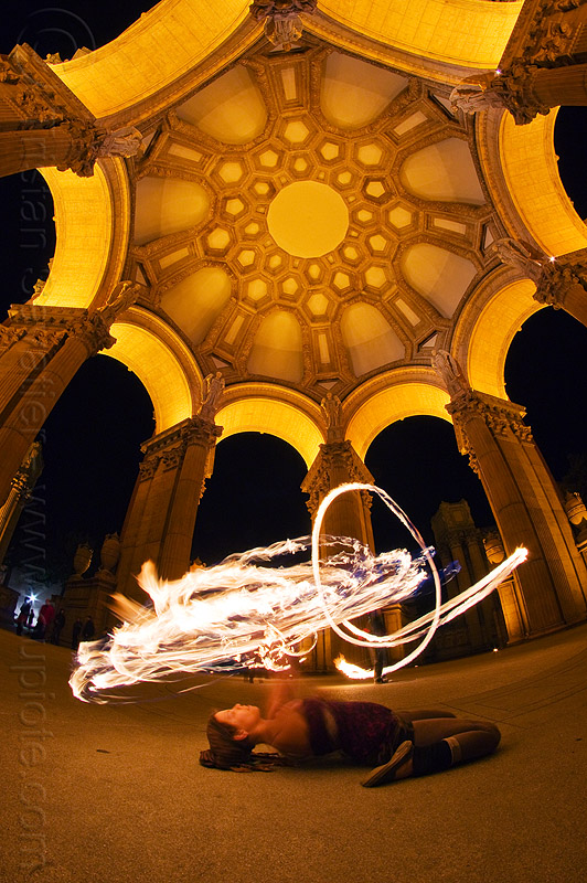 frankey lying on her back - spinning fire hoop - fire dancer at the palace of fine arts, arches, dome, fire dancer, fire dancing, fire hoop, fire performer, fire spinning, frankey, night, palace of fine arts, vaults, woman