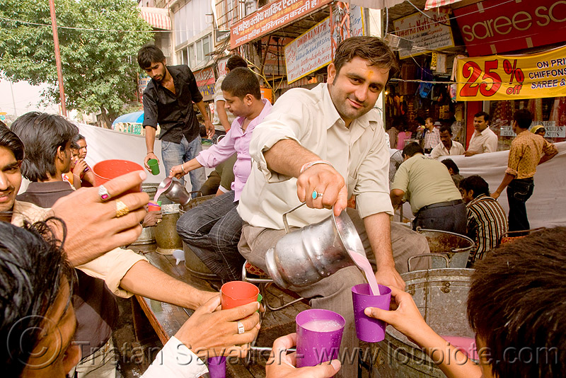 free pink drinks - hindu holiday - delhi (india), cups, free drinks, hands, jar, people, pitcher, plastic cups, pouring, street, water
