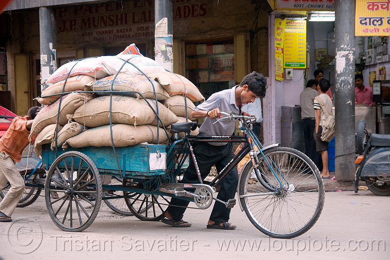 freight tricycle with heavy cargo load - delhi (india), bags, bearer, cargo tricycle, cargo trike, cycle rickshaw, delhi, freight tricycle, freight trike, heavy, load, man, moving, porter, street, wallah