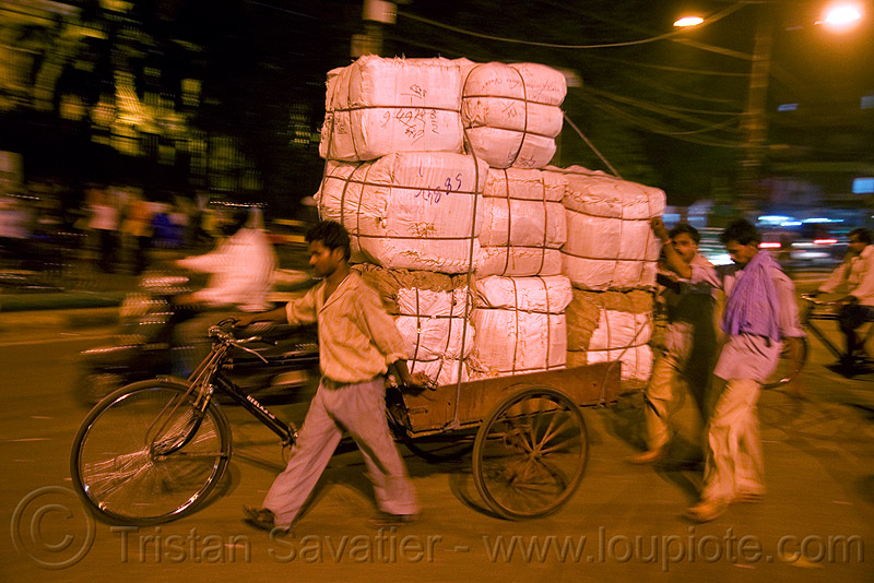 freight tricycle with heavy load of cargo - delhi (india), bearer, cargo tricycle, cargo trike, cycle rickshaw, freight trike, men, moving, night, people, porter, street, wallahs