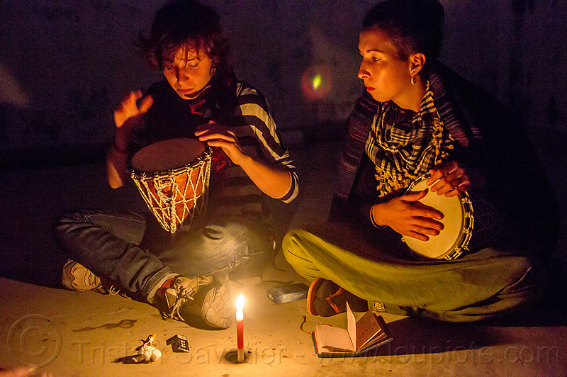 friends with drum sitting around candle (india), candle, djembe drum, drummer, drumming, india, malou, night, sitting, varanasi, women